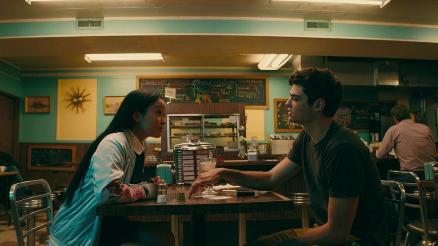 """A photo still from the Netflix movie """"To All the Boys I've Loved Before"""" that shows Lara Jean and Peter at a diner."""
