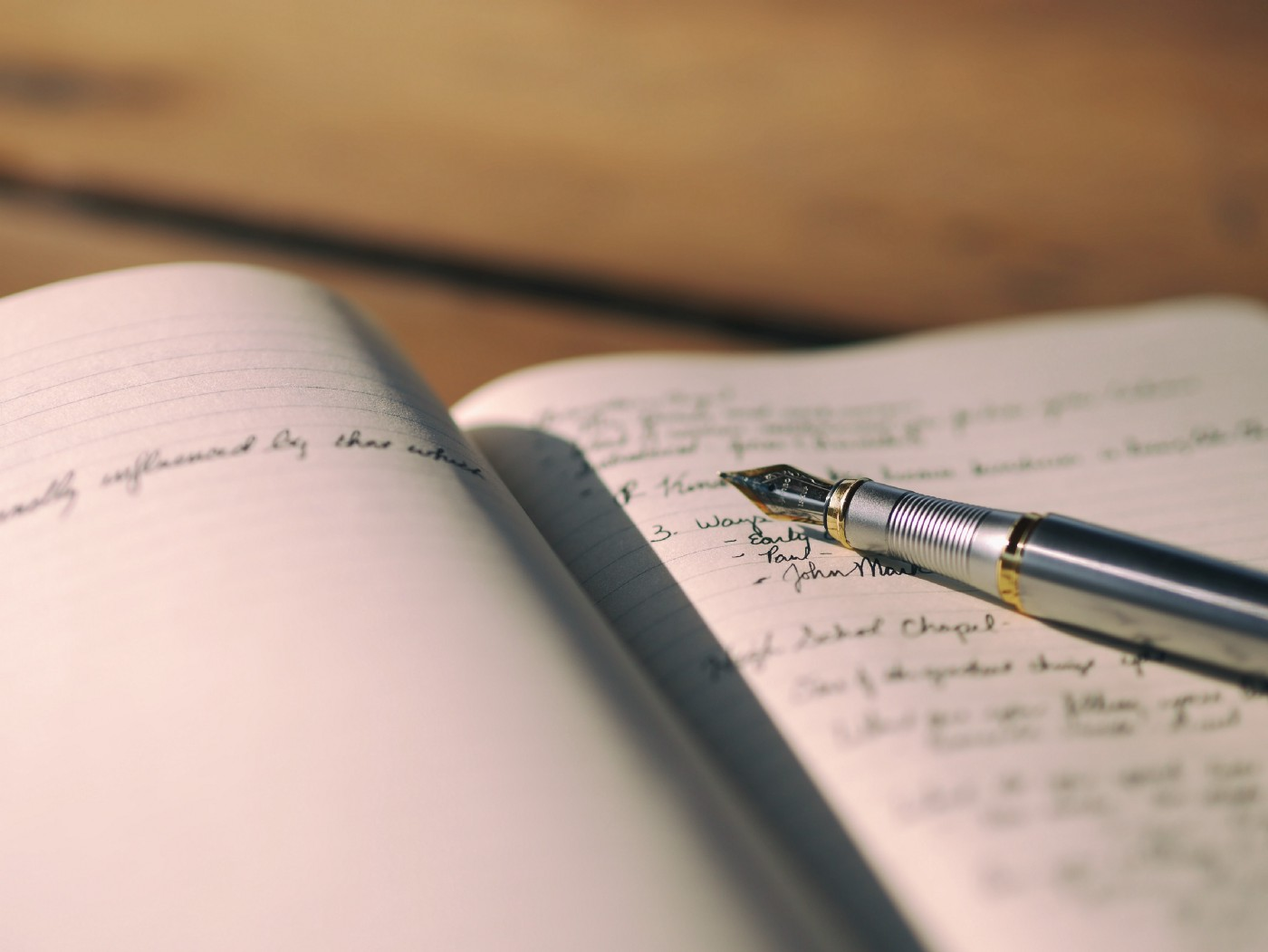 Photo of journal, pencial, and writing