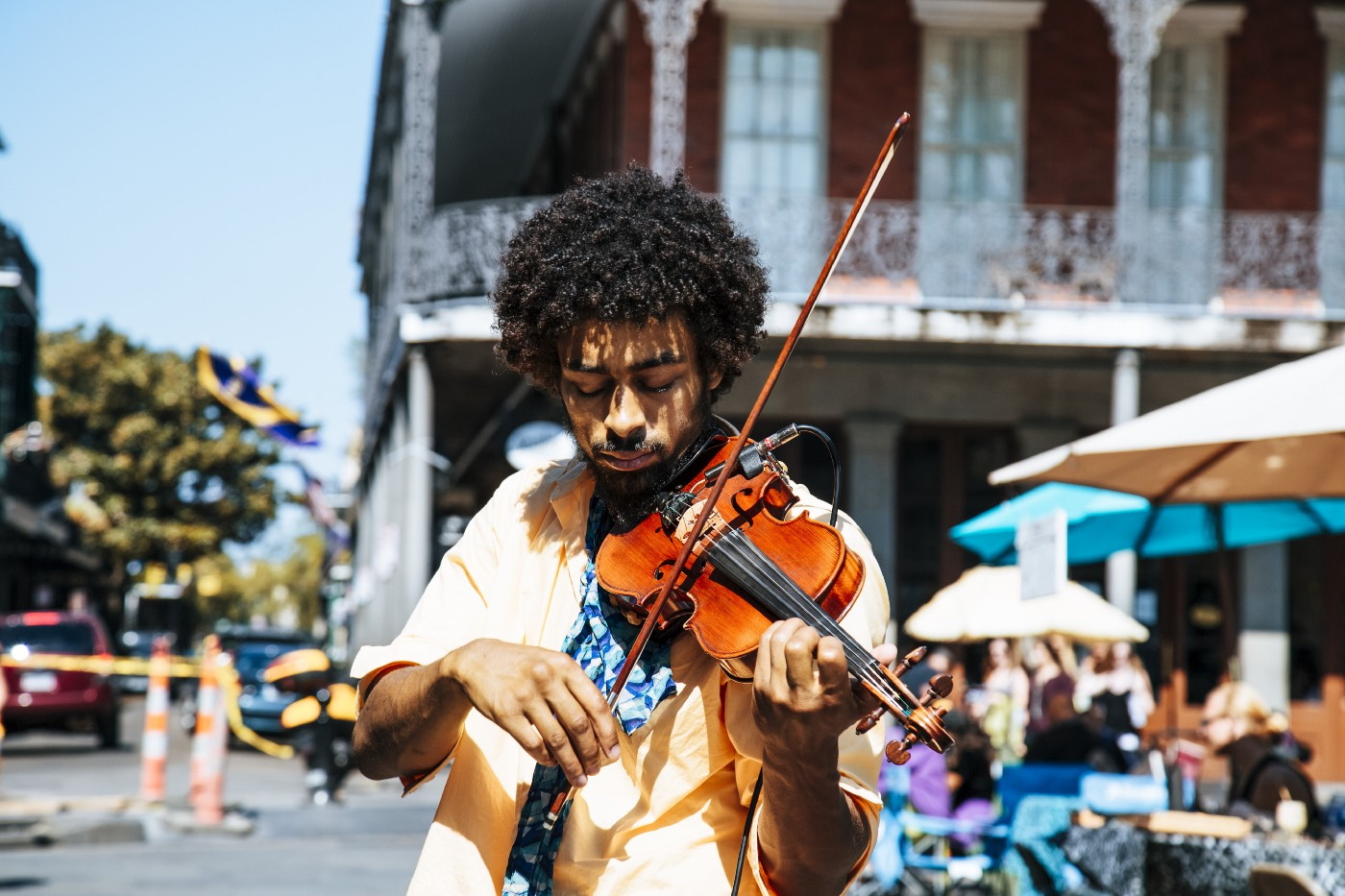Man plays violin on street corner