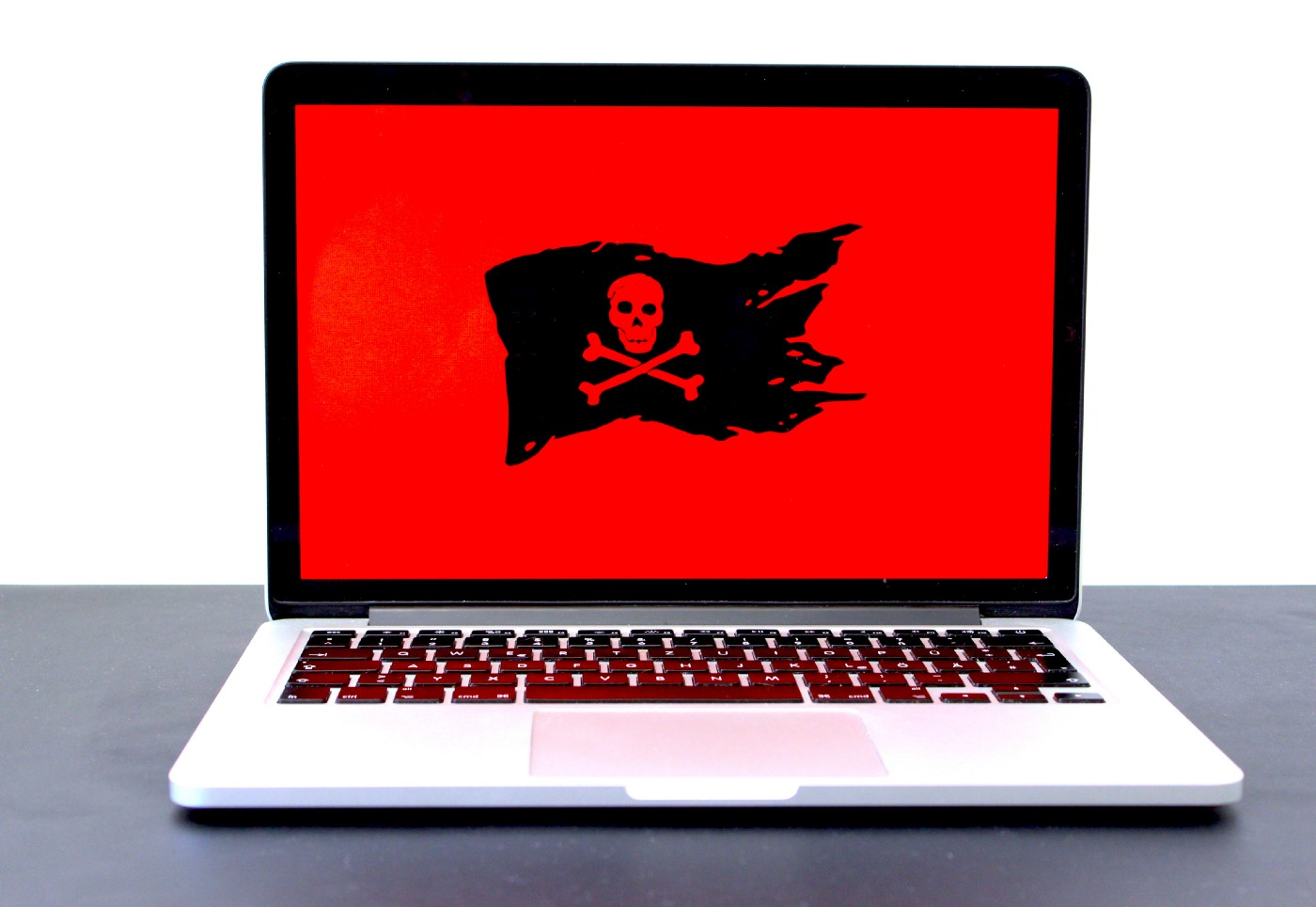 Laptop computer with skull and crossbones for a computer error