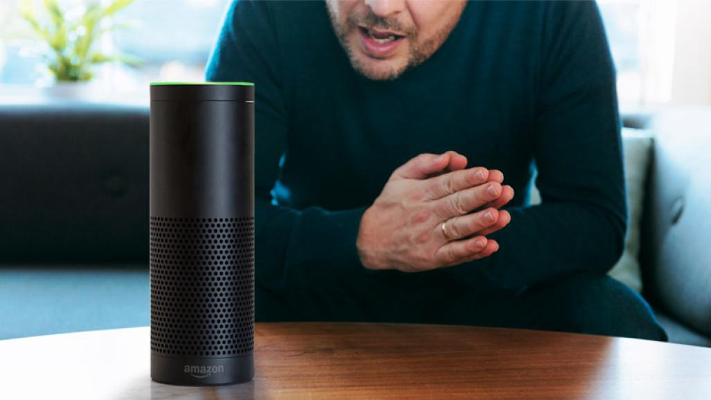 A man talks to an Amazon Alexa device
