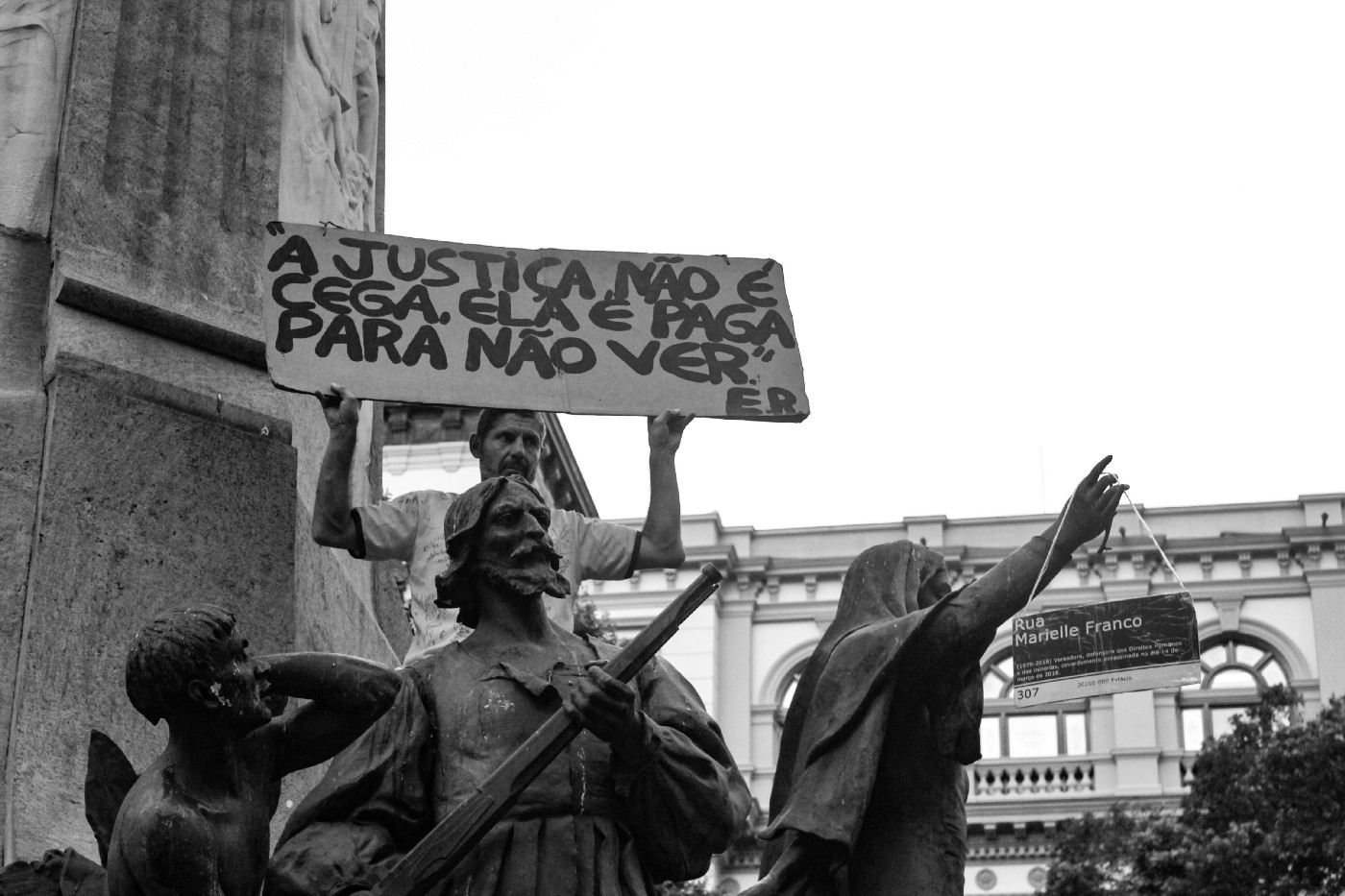 black and white photo of a lone protestor in Brazil