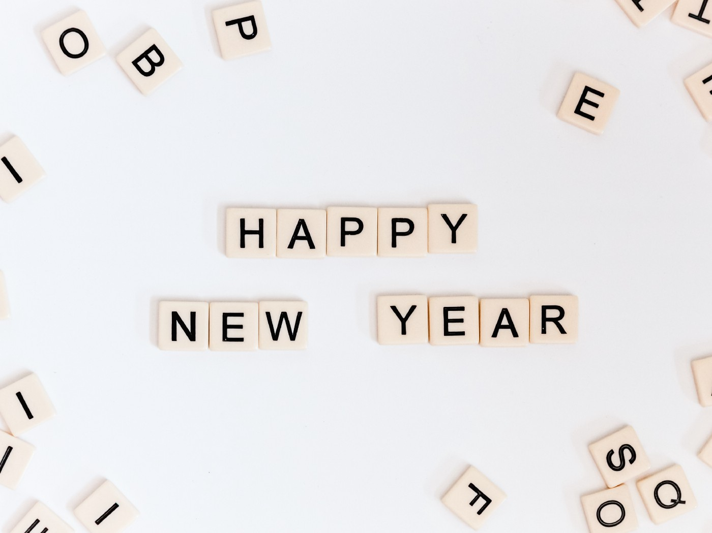 """Happy New Year"" spelled out with wooden squares with black letters on them"