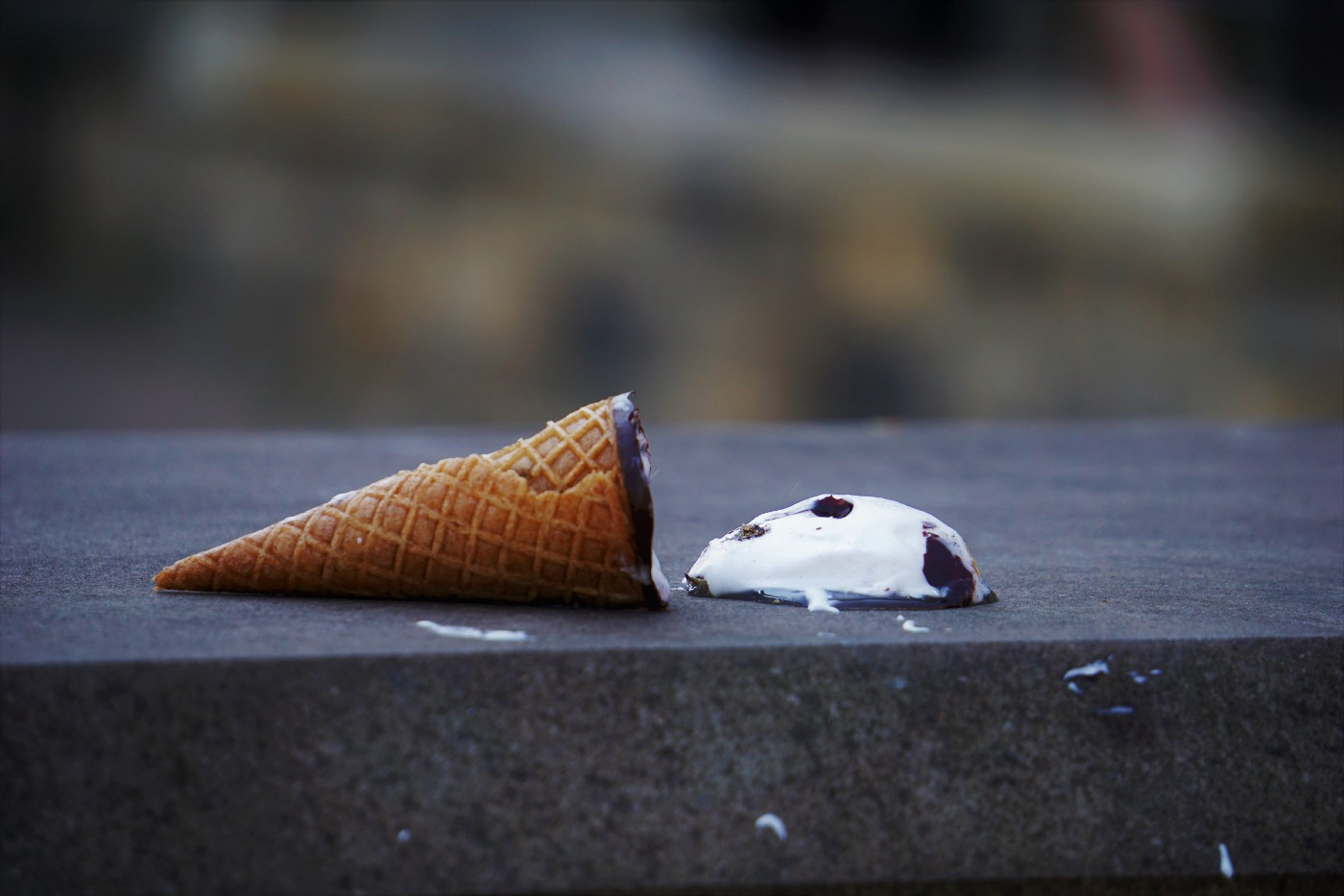 Ice cream cone melts where someone accidentally dropped it