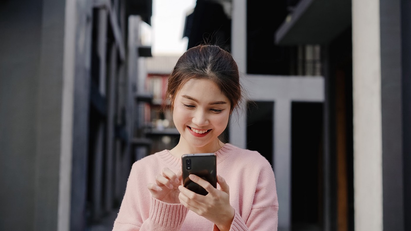 Young woman checking out an influencer marketing campaign on a social media platform
