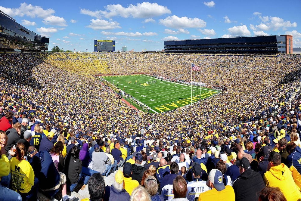 A huge outdoor football stadium filled with 100,000 people.