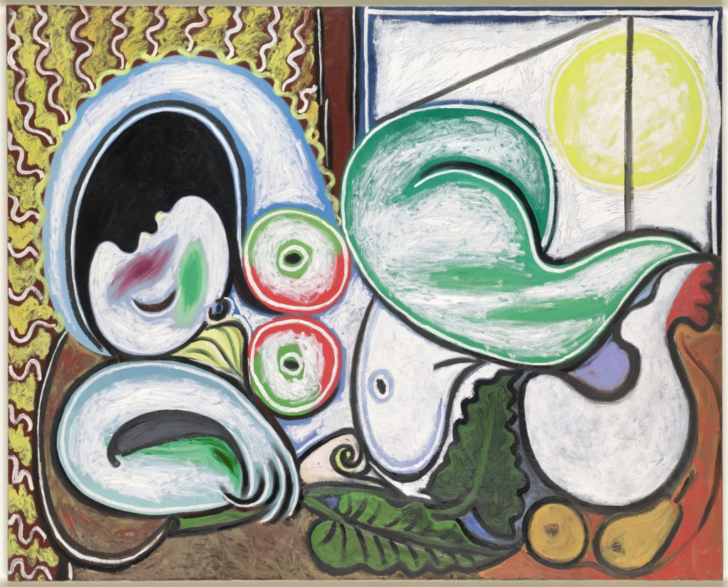 Pablo Picasso painting of a reclining nude on a couch by a window and houseplant.