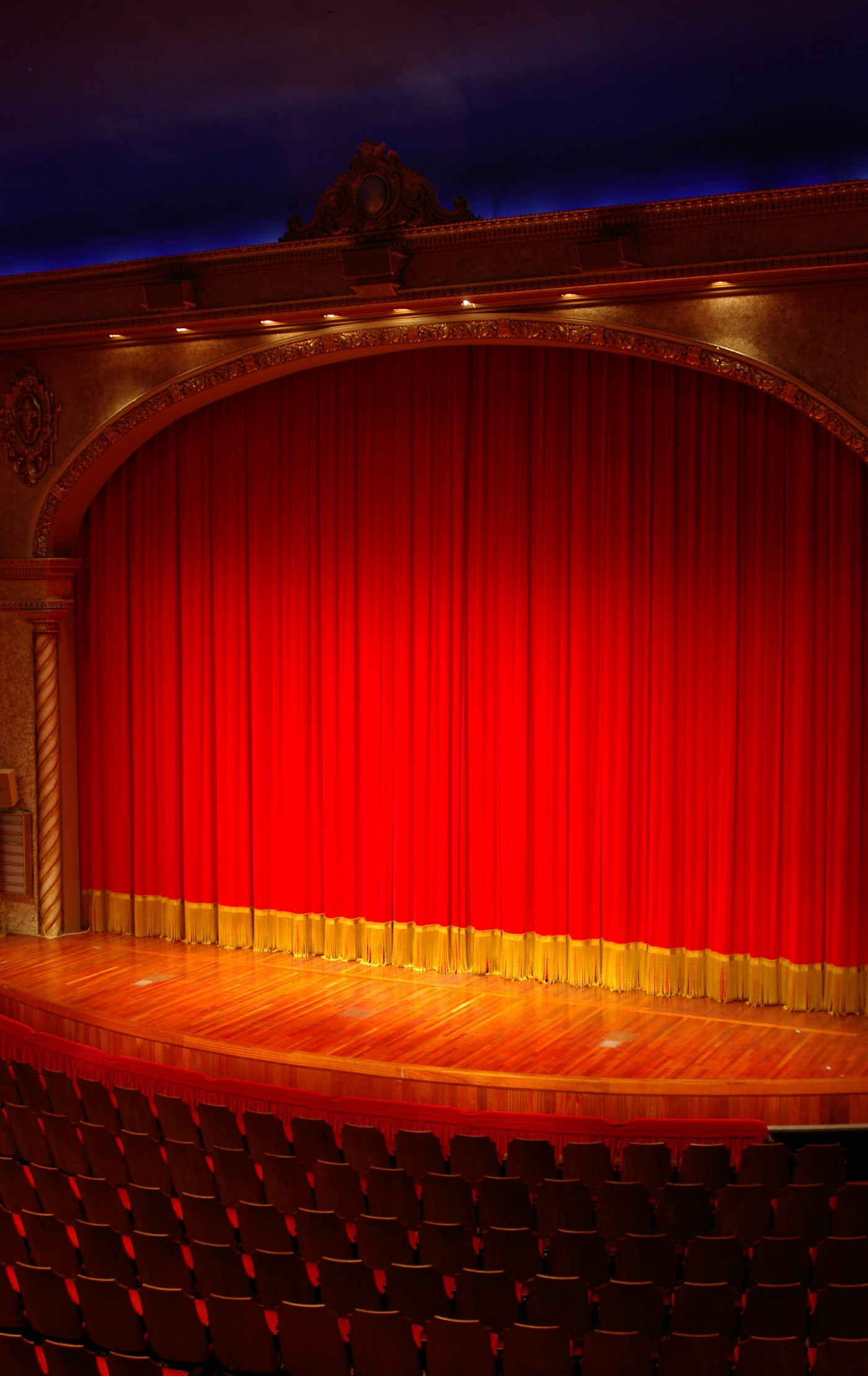 A stage with a red curtain before a play.