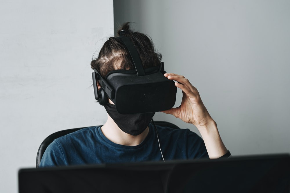 Man wearing a mask and a VR headset