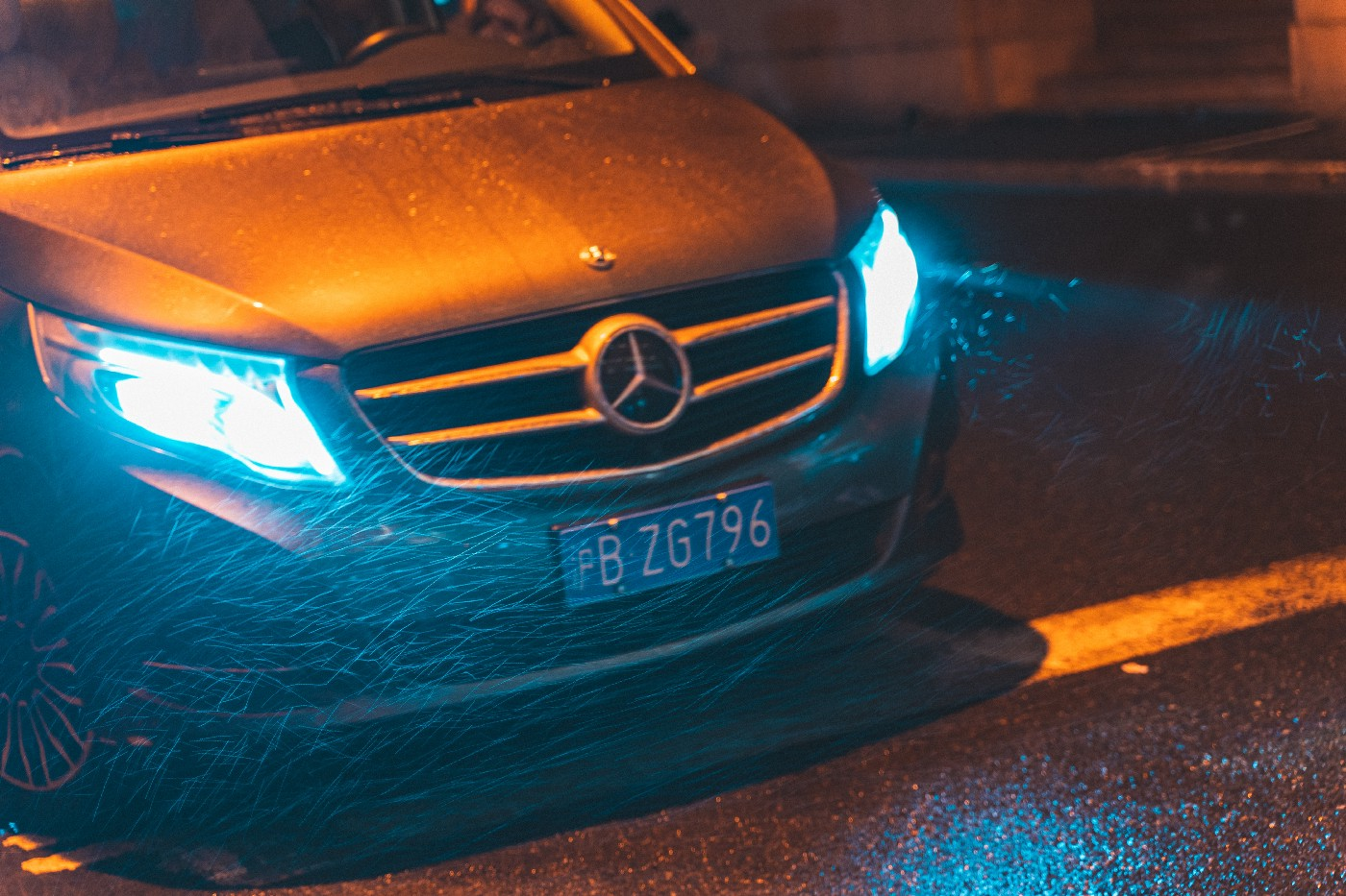 Photo of a Mercedes at night in the rain