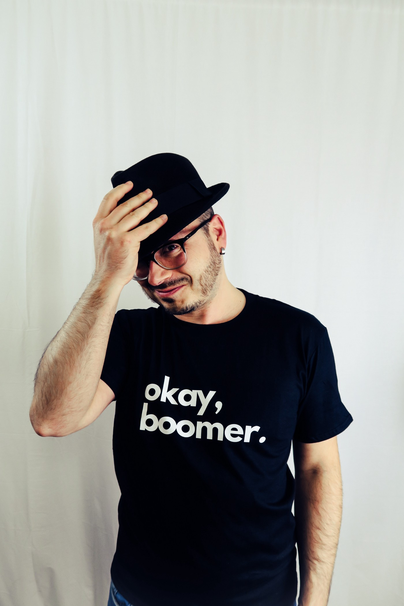 Man wearing okay, boomer t-shirt