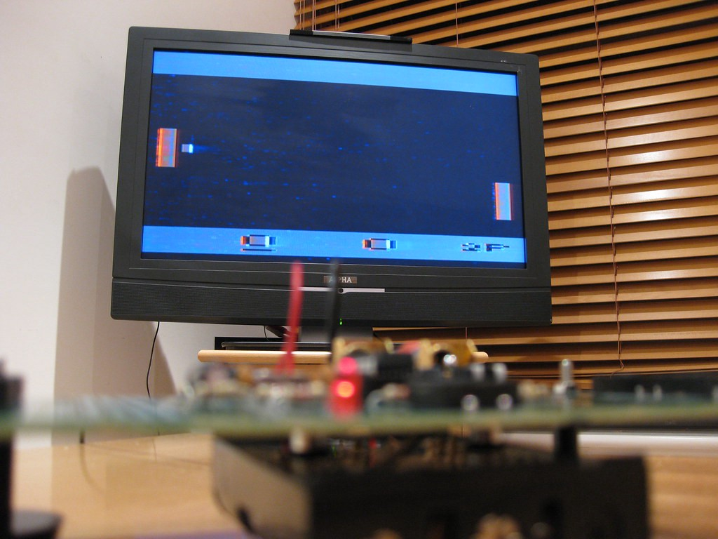 A retro video screen showing a game of 'Pong'
