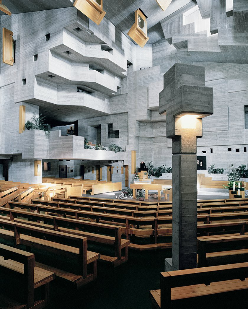 The church interior features locally sourced concrete and wood. Gaps between the shifting, interlocking geometries bring light into the central worship space. (Photo: David Willen, The Tale of Tomorrow)