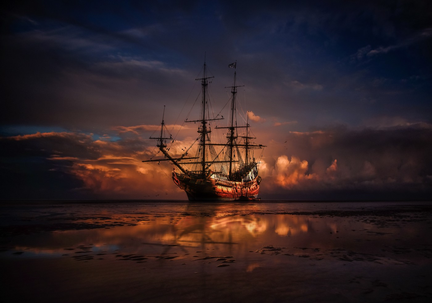 Photo of an ominous looking pirate ship at dusk.