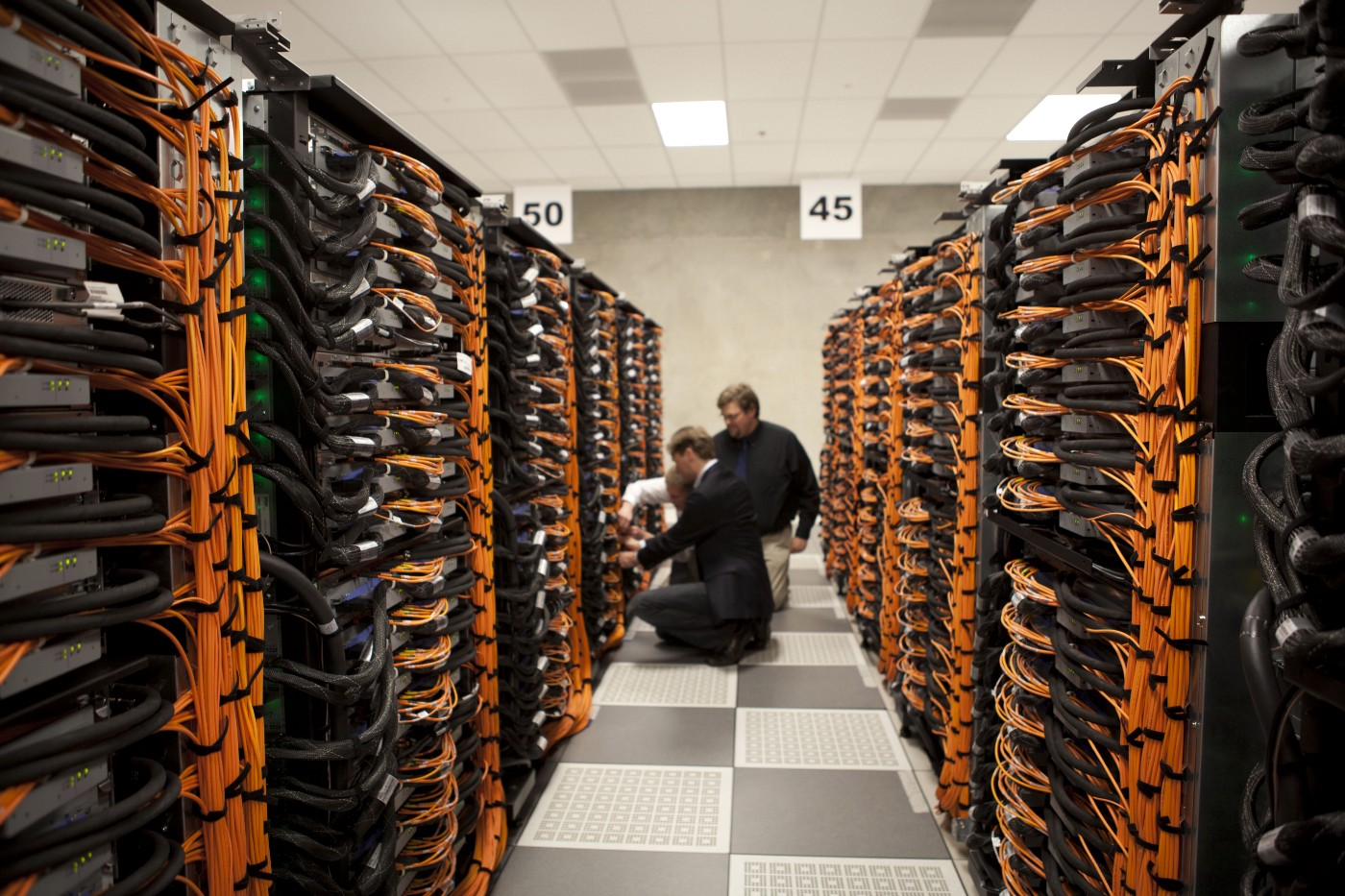 An image of a bunch of servers in a data center.