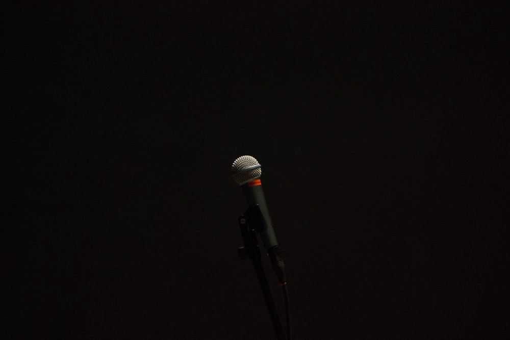 Black corded microphone on a black background