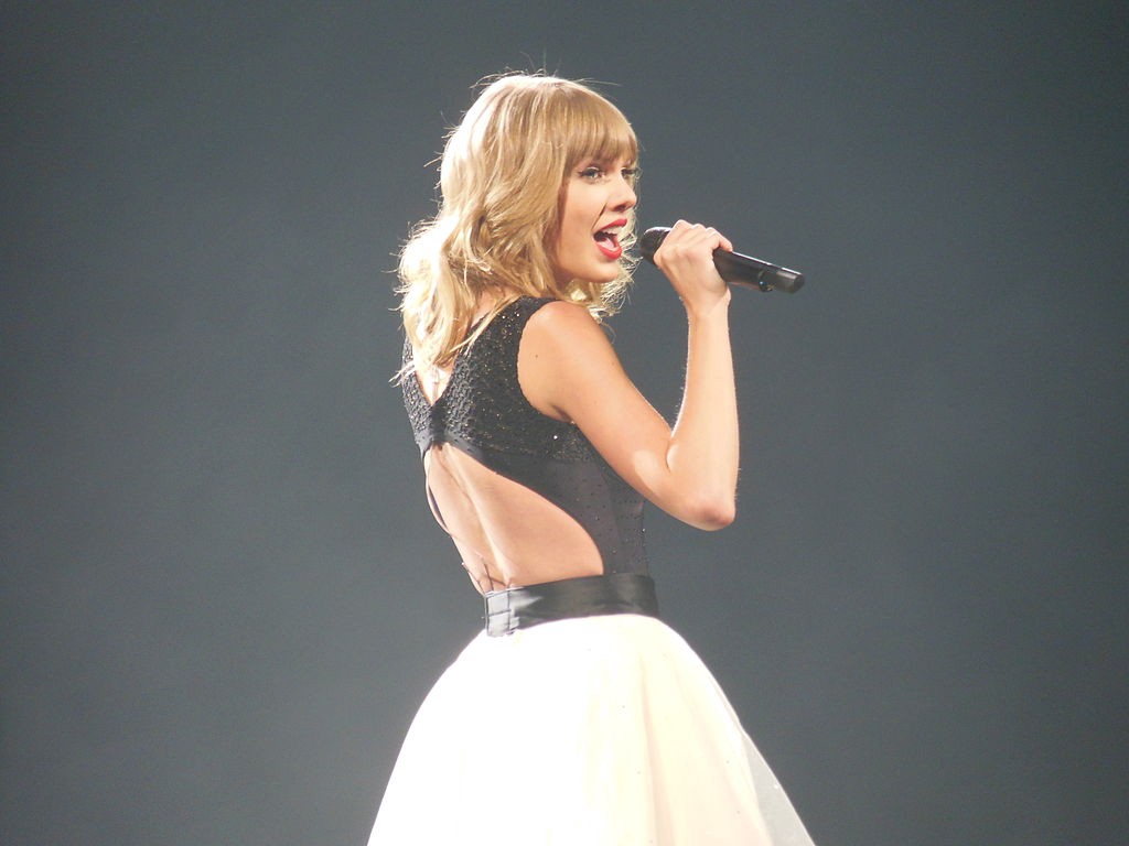 Taylor Swift singing into microphone