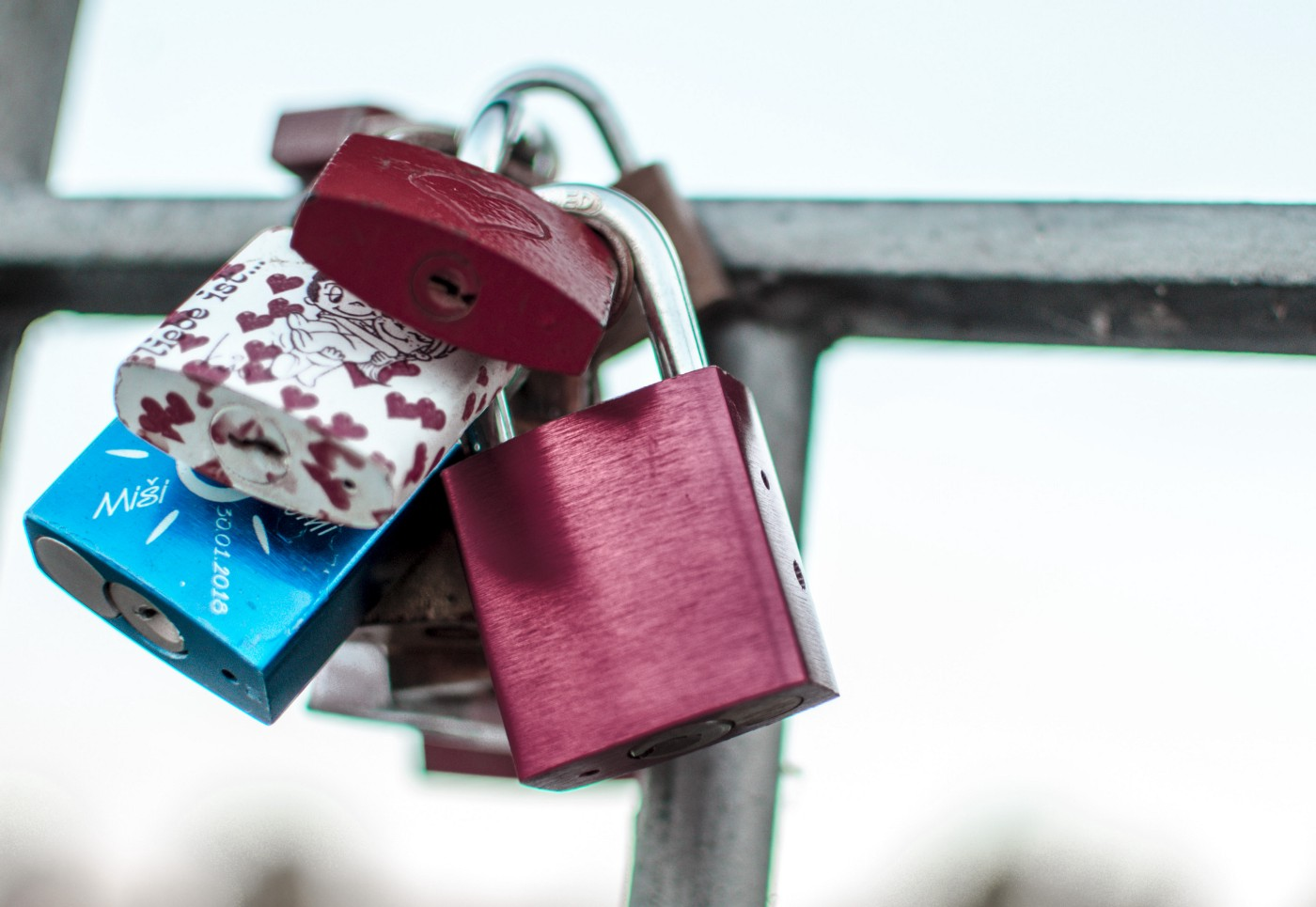 "Picture of ""love padlocks"" on a fence."