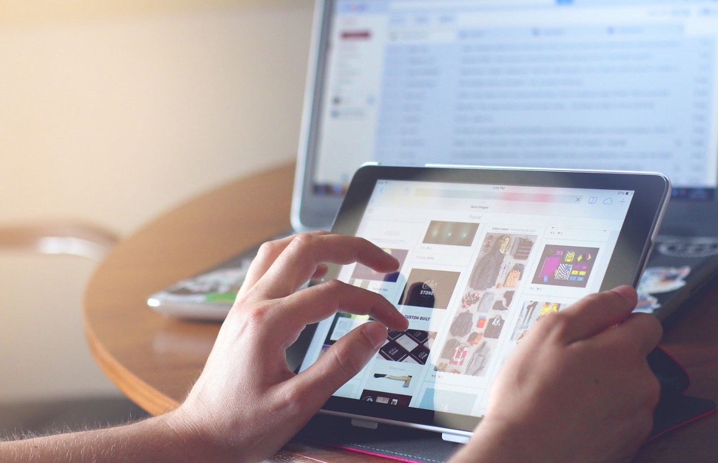 Person shopping ecommerce site on a tablet.