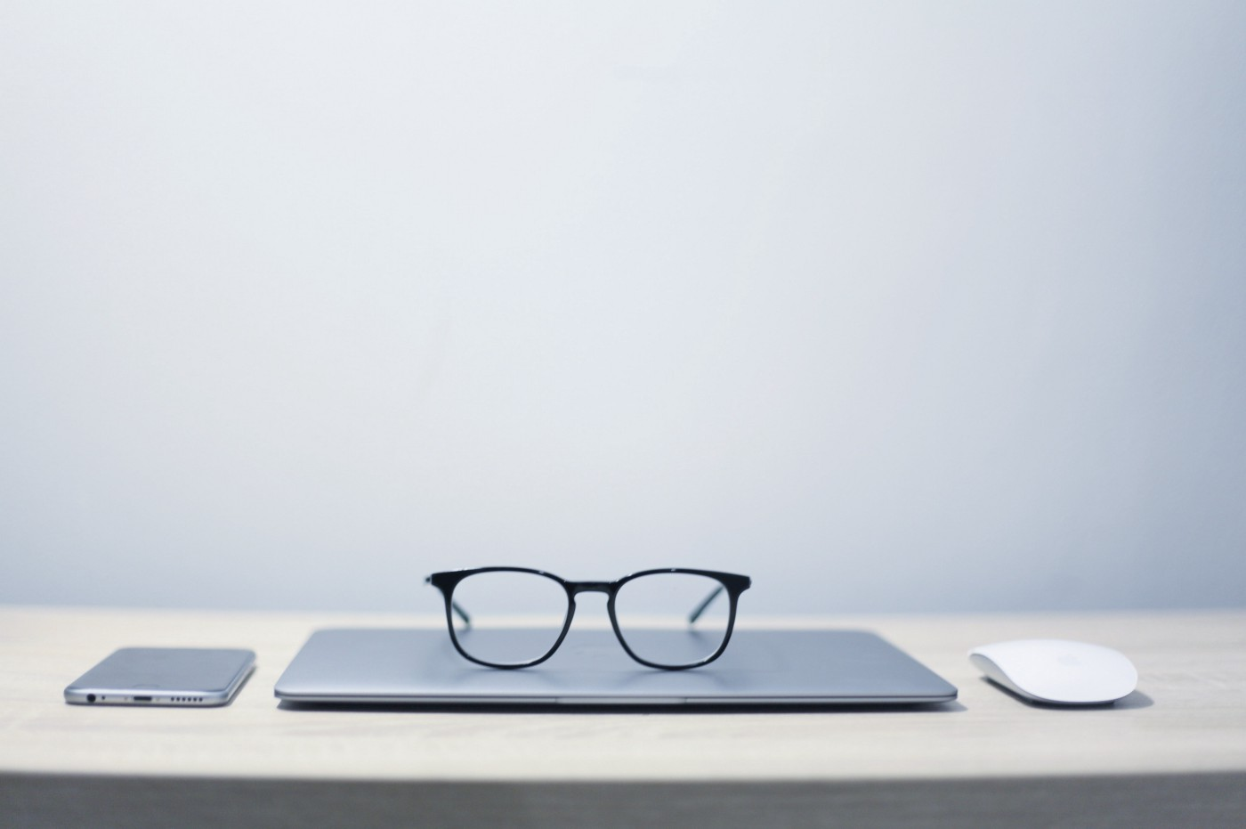 Pair of glasses sitting on a laptop