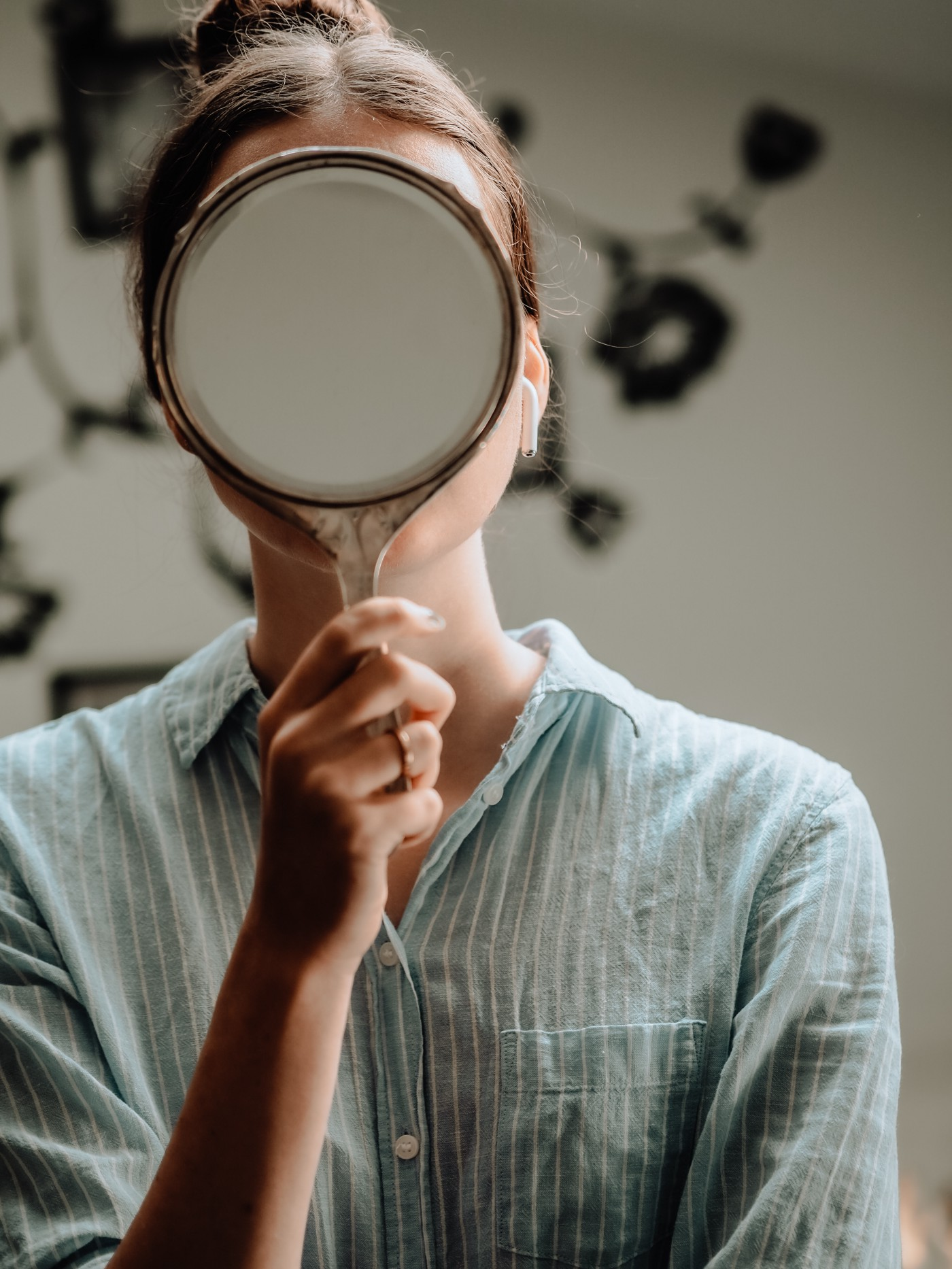 mirror hides the person's face