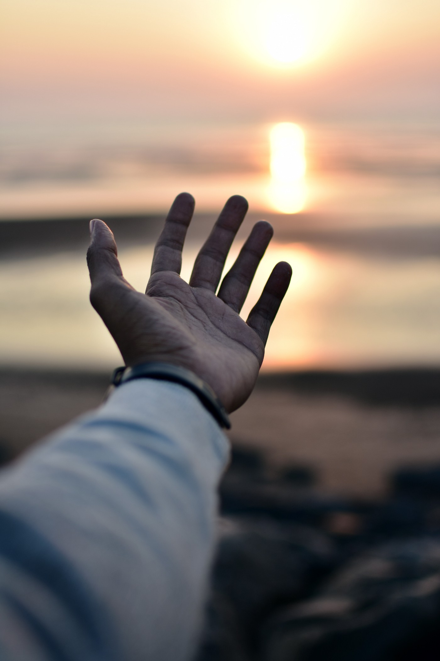 A hand and a sunset