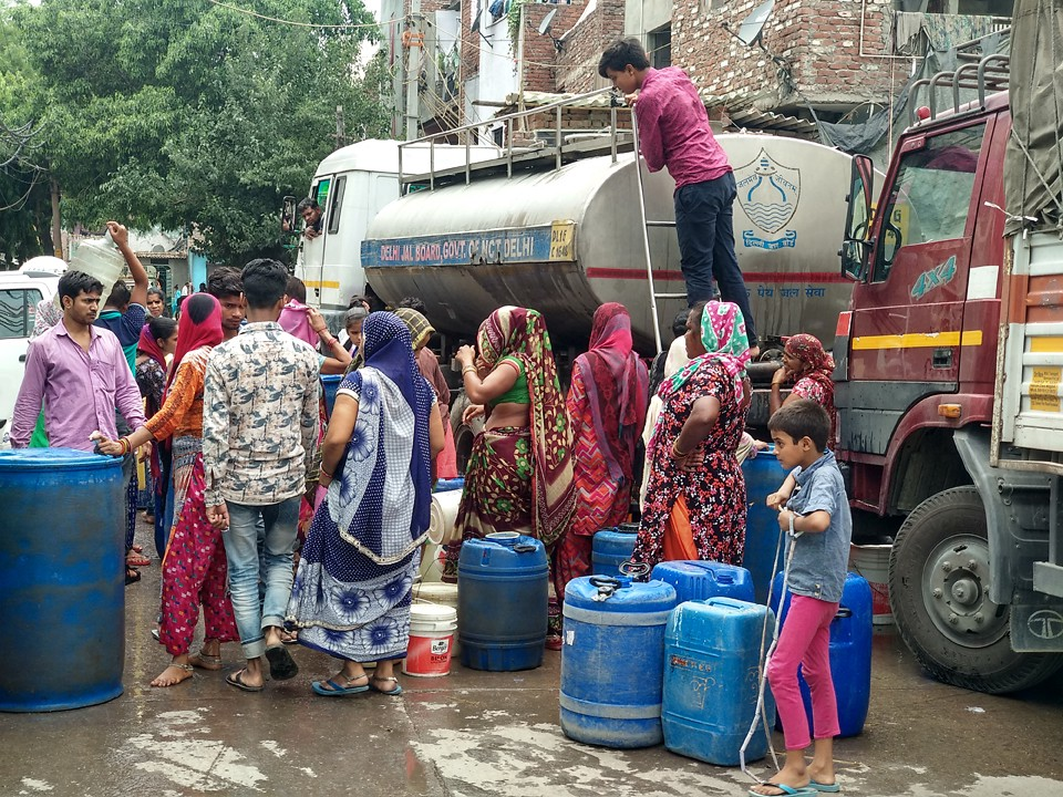 People queueing in front of a government water truck waiting for their turn in Delhi, India. File photo. March 2019.