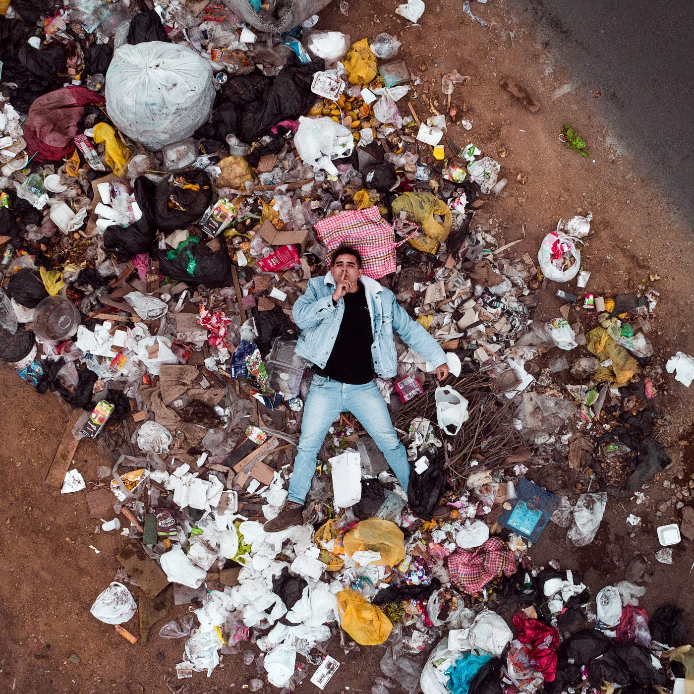 Person laying in trash.