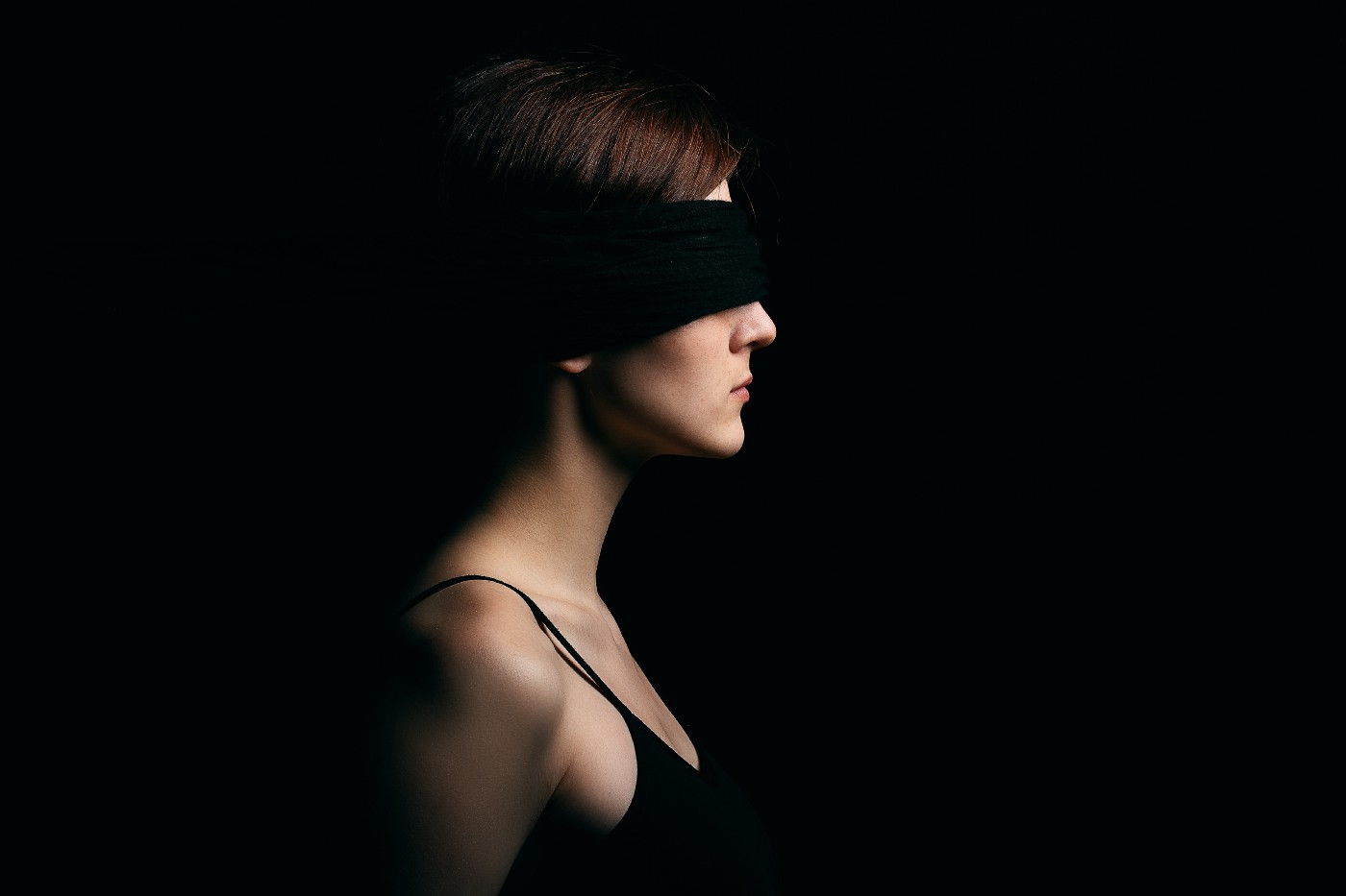 A woman in a blindfold.