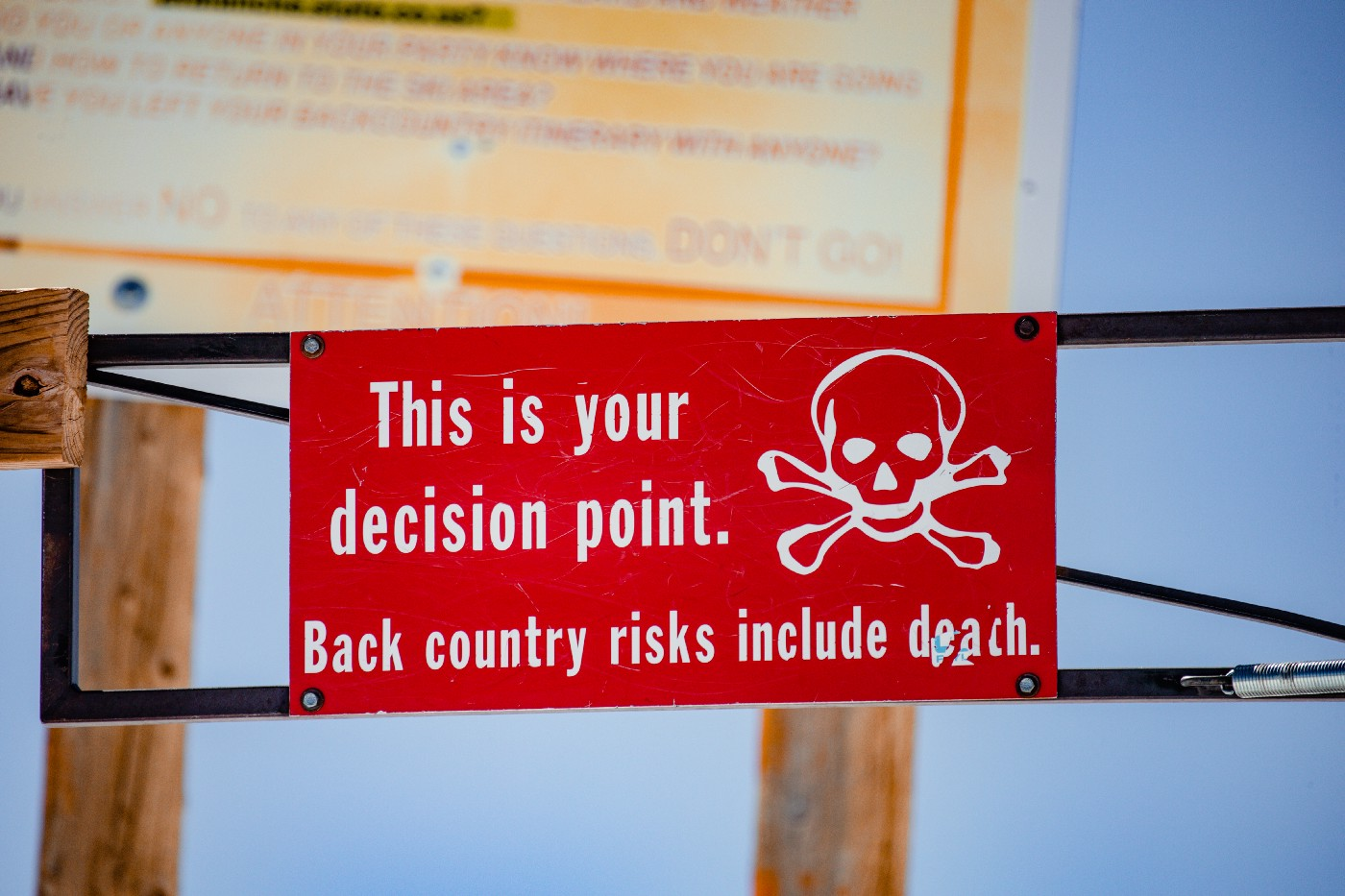 """red sign with a skull and crossbones saying """"this is your decision point"""""""