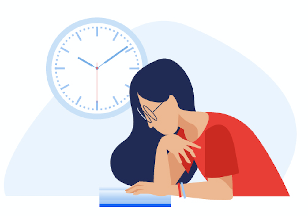 High school student studies her textbook while a clock ticks in the background