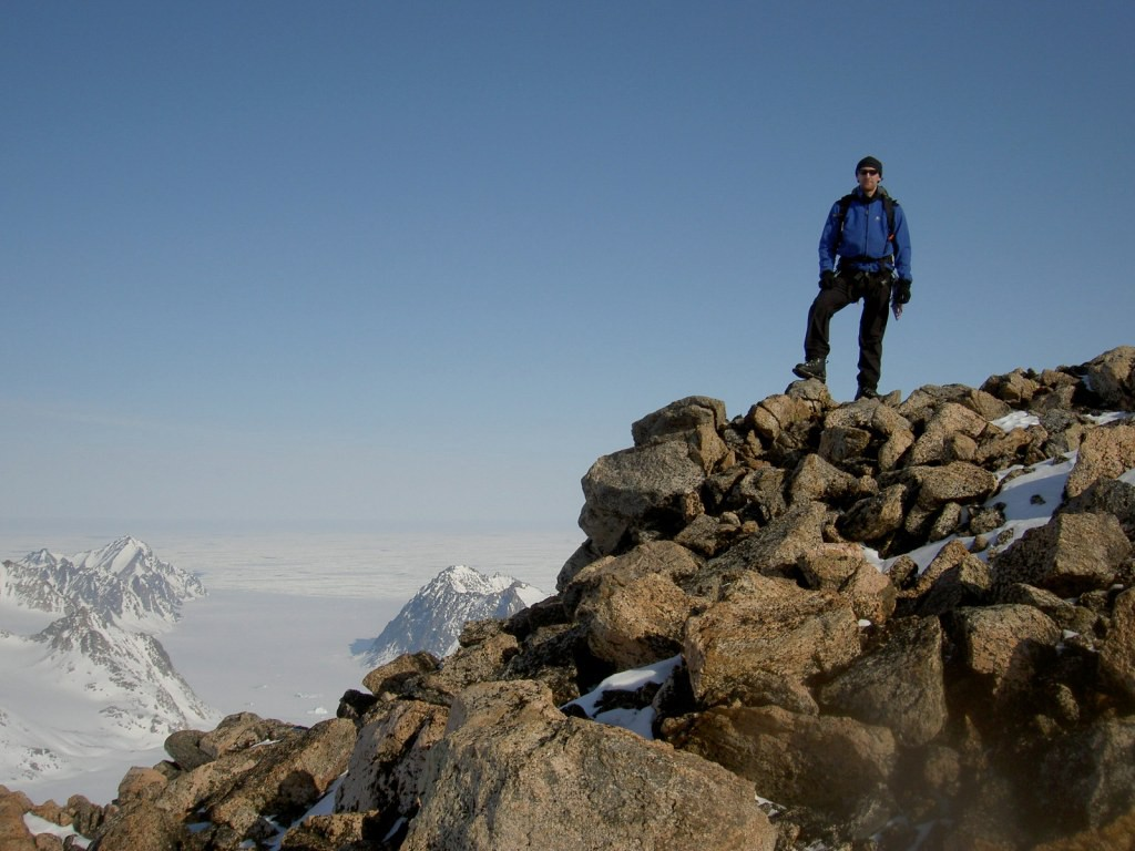 Author standing atop a mountain in Greenland