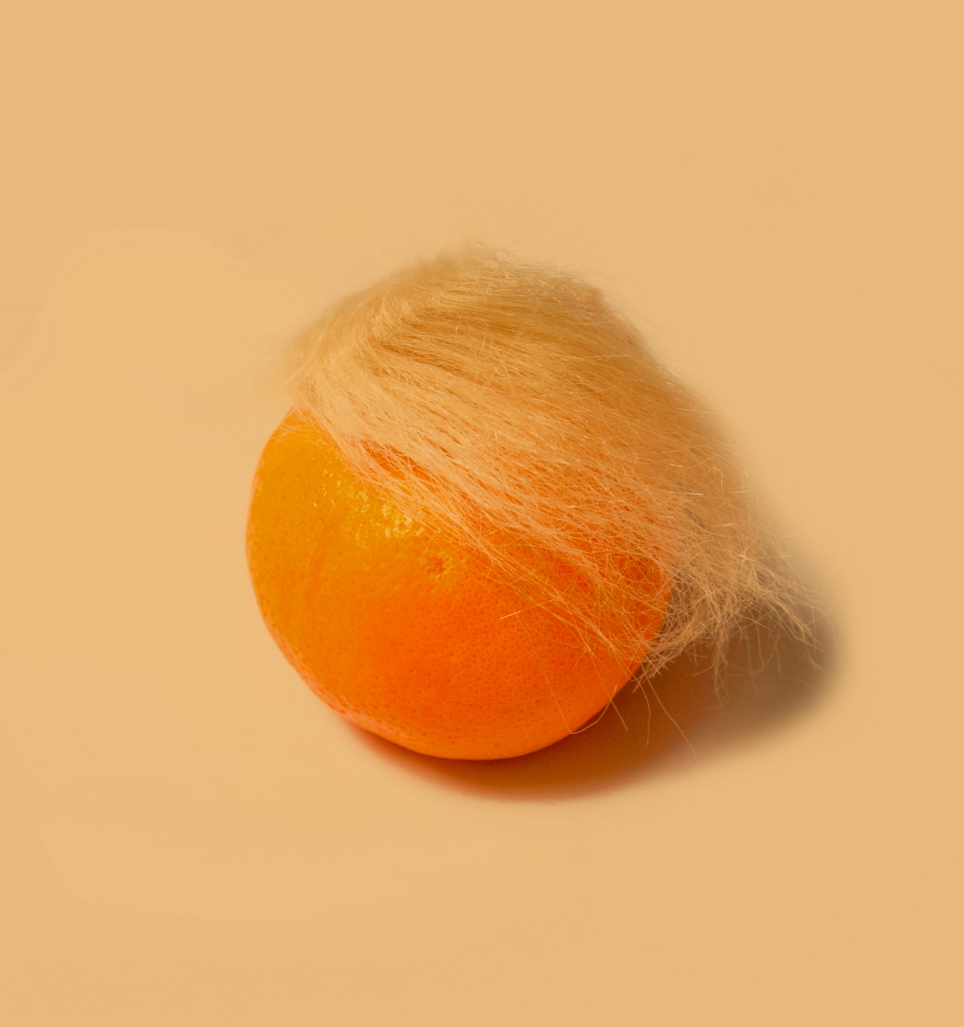 An orange with a white wig