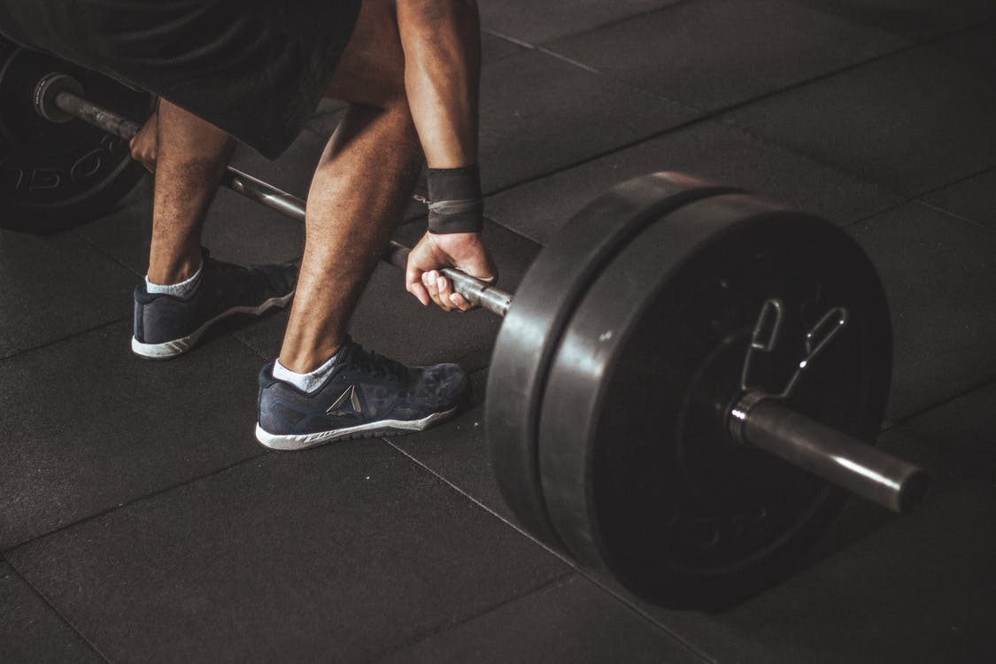 Man about to lift a barbell off the floor