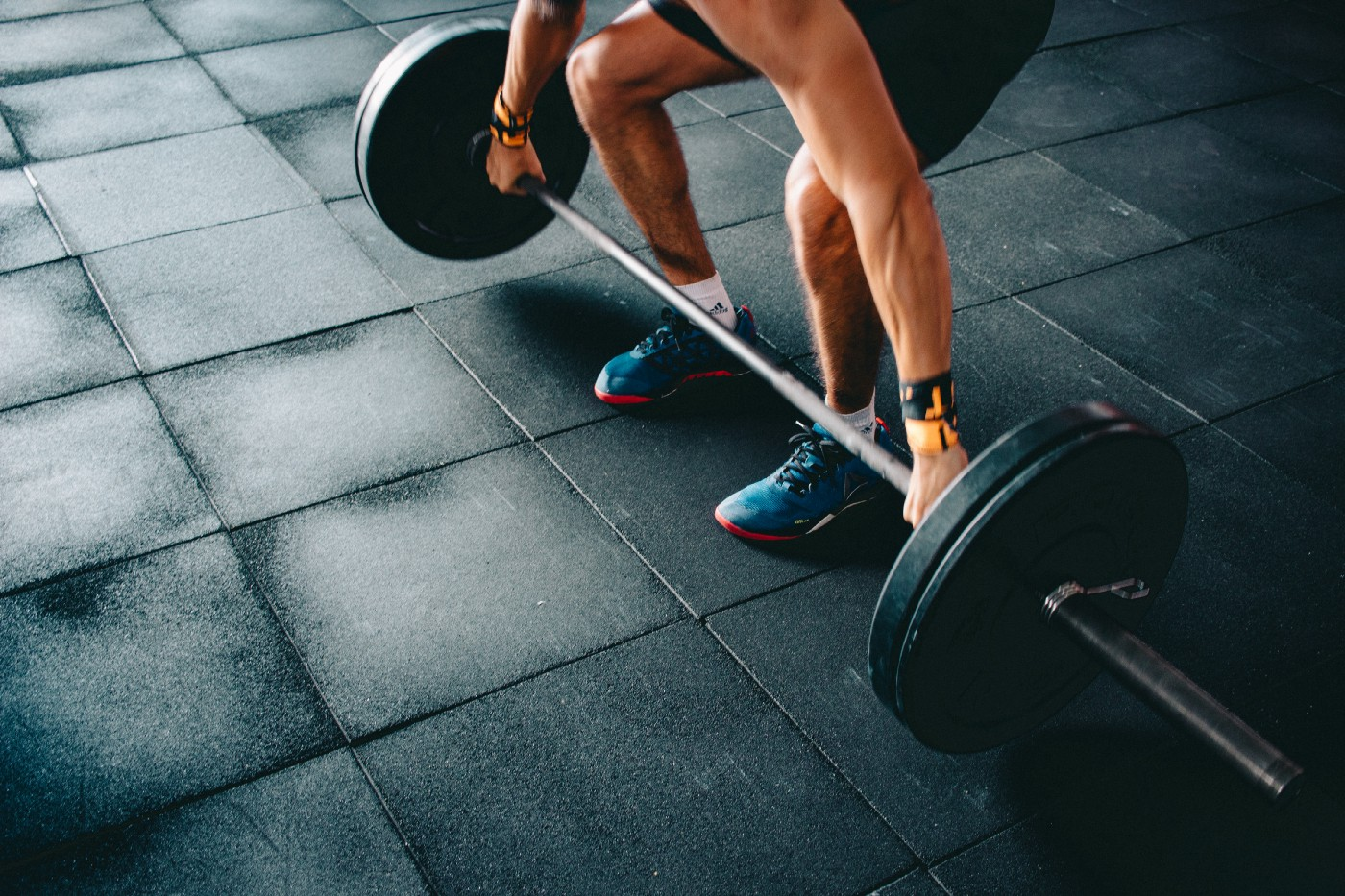 Athlete with wide grip on barbell lifting weights.
