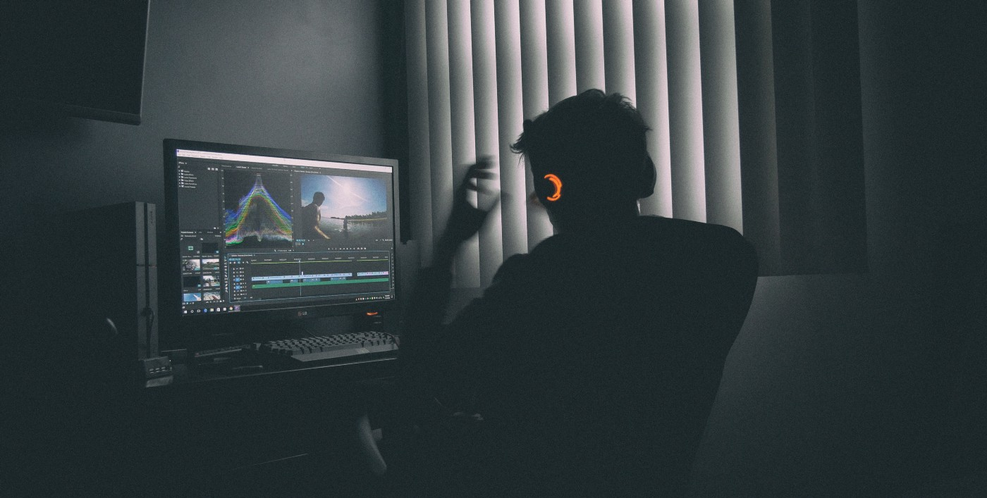 Man working on computer using Premiere Pro