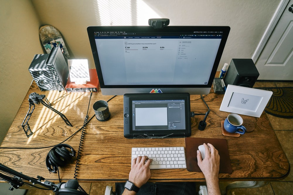 a creator working with multiple devices on a desk