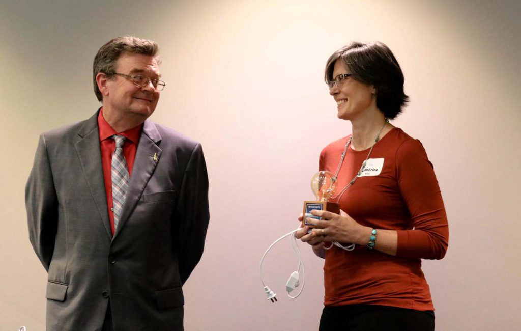 """Dr. David Norton with """"Invention of the Year"""" awardee Dr. Catherine Price. (Photo by marketing intern Andrea Dautant)"""