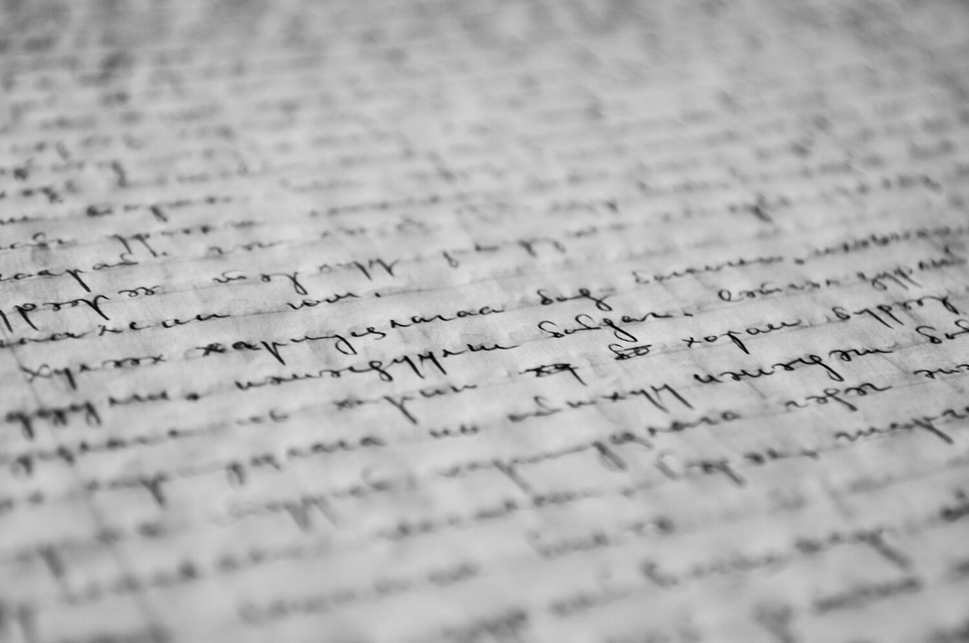 A piece of paper filled with illegible cursive writing.