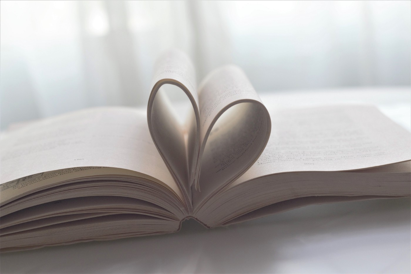photo of book with pages in shape of heart posted on mickey markoff intro to inspirations website