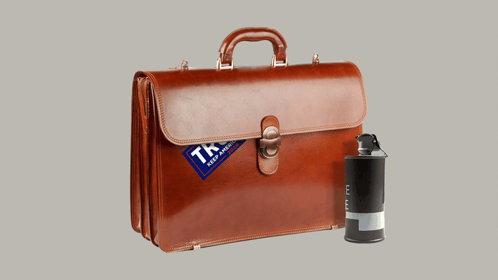A leather briefcase with a Trump sticker tucked under the flap, next to what looks like a canister of tear gas.