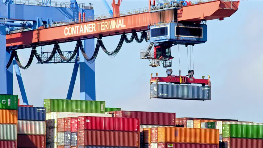 A crane carrying shipping containers