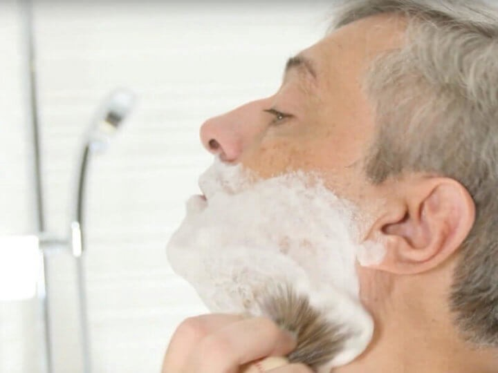 lathering with a shave brush