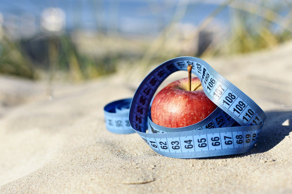 A tape measure is wrapped around an apple. #dieting #bodyimage #weightloss #weightgain #diet #loseweight #weight #apple