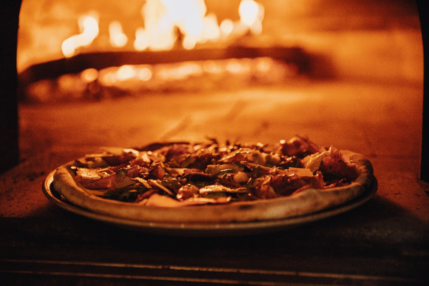 Pizza being cast into the proverbial flames of the human body.