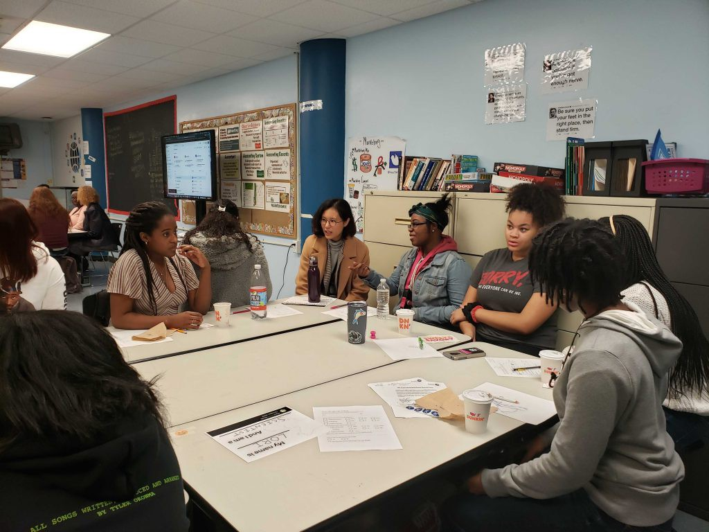 Ambitious female students immersed in a roundtable discussion