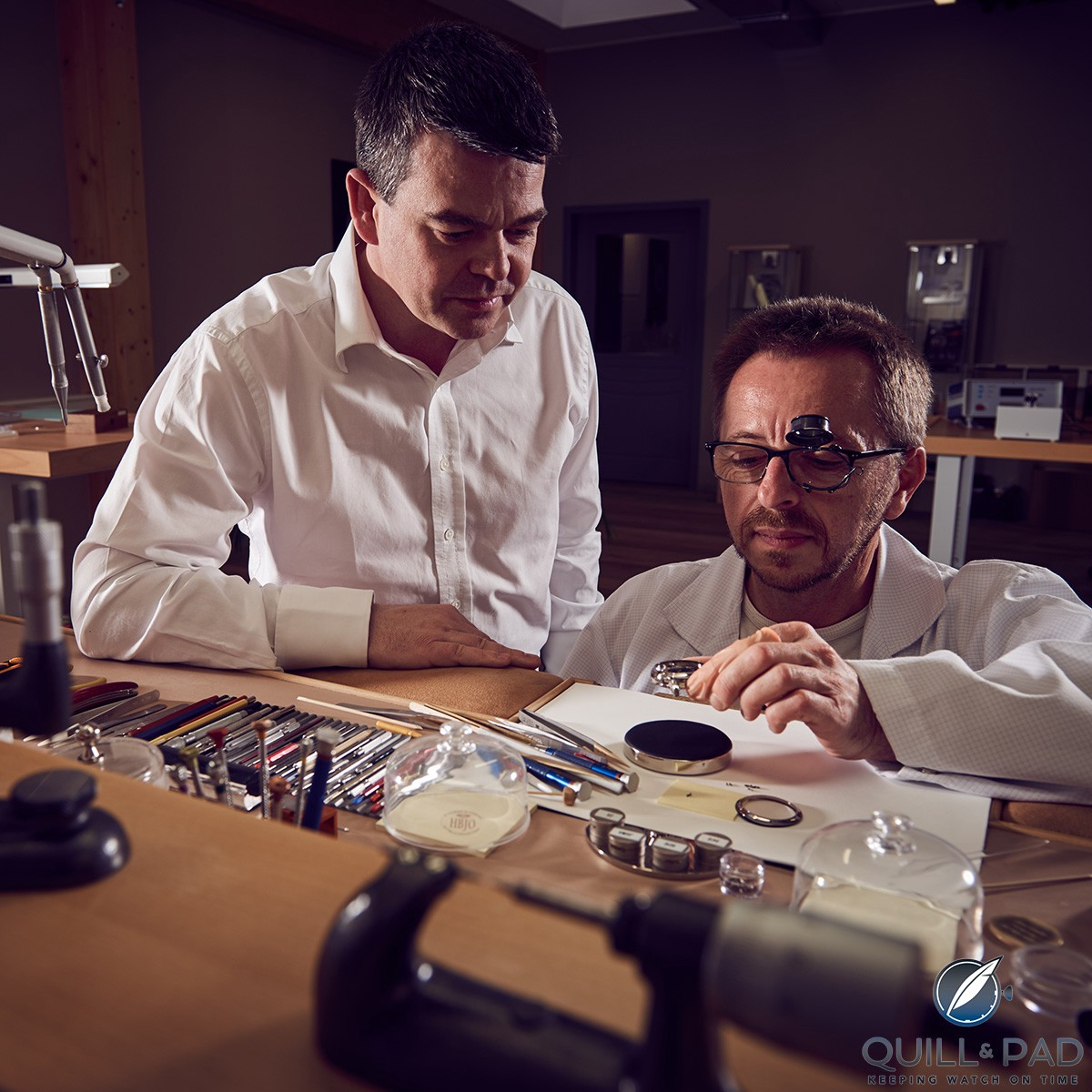 Romain Gauthier (left) and watchmaker Patrick Martin in the brand's atelier in Le Sentier