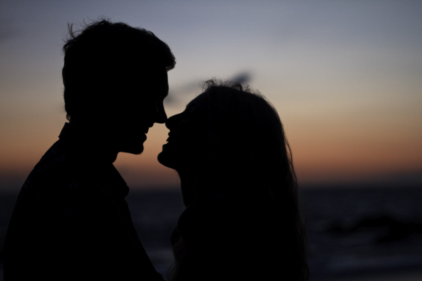 Couple kissing in the dark
