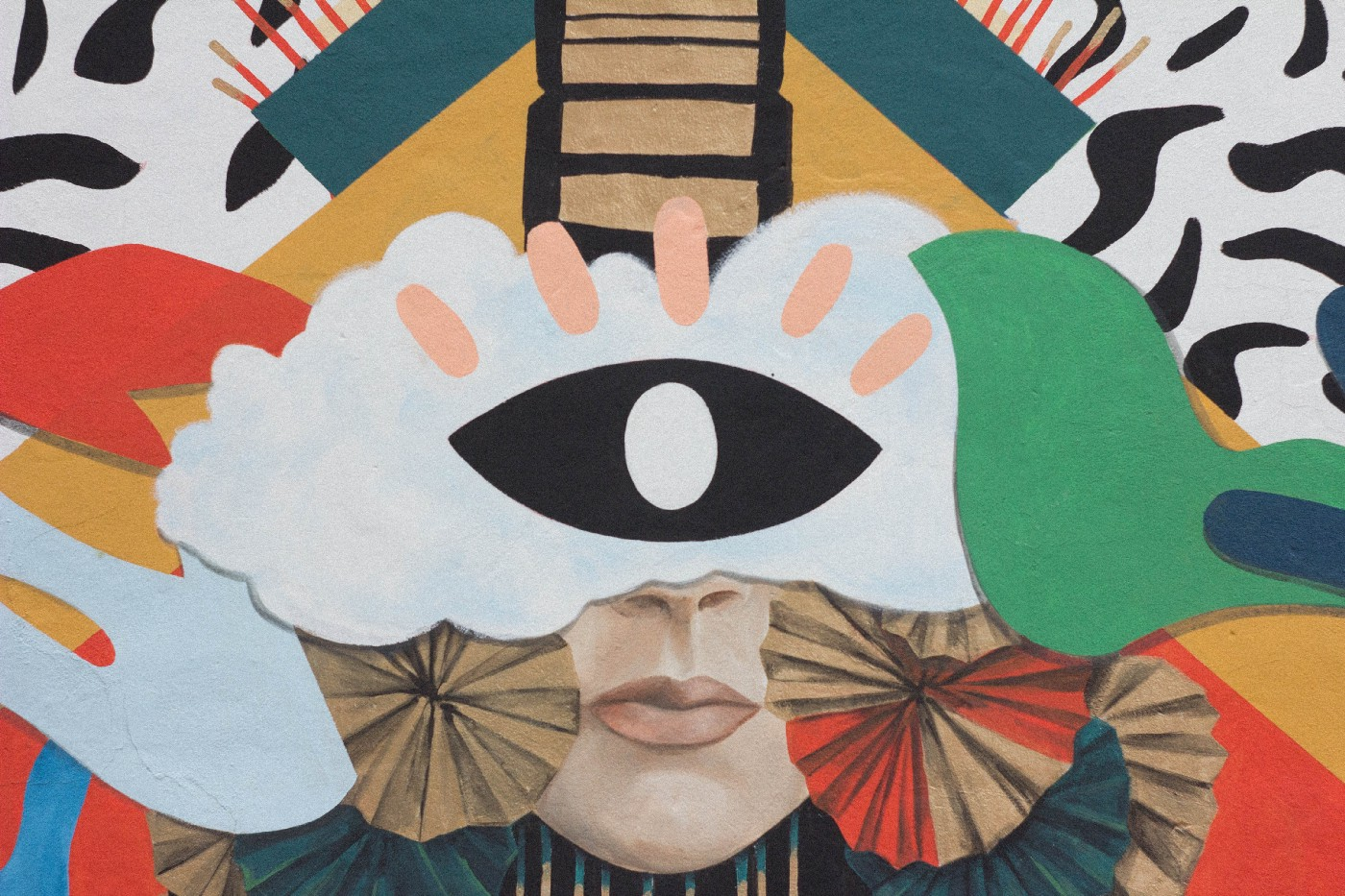 A collage with an eye over a face, and other abstract elements.