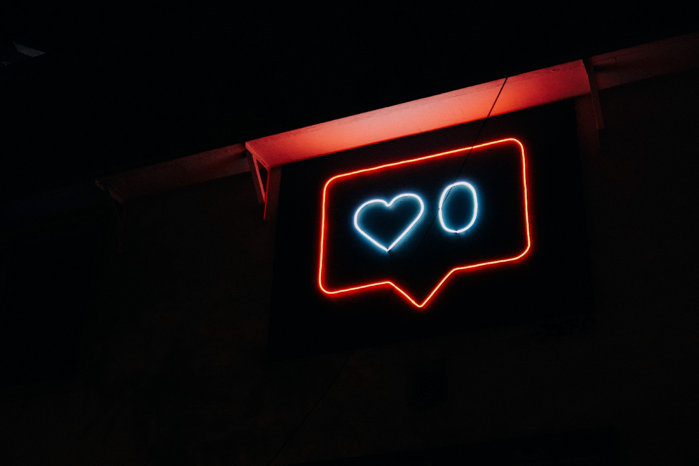 Neon sign of a heart button.